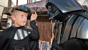 Eight-year-old Ryan Antalek of Valatie lifts the mask of his own Darth Vader costume to get a good look at a real Darth Vader during Star Wars night at Joe Bruno Stadium before Saturday's game between Aberdeen IronBirds at Tri-City ValleyCats July 18, 2015 in Troy, NY.  (John Carl D'Annibale / Times Union)