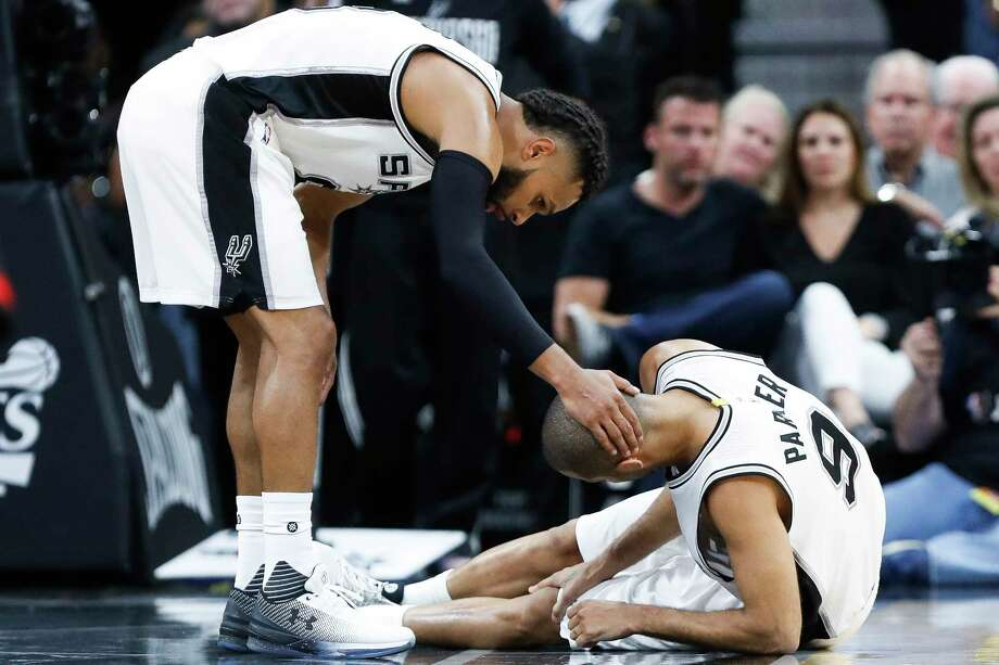San Antonio Spurs guard Patty Mills (8) puts his hand on guard Tony Parker's (9) head after he was injured during the second half of Game 2 of the second-round of the Western Conference NBA playoffs at AT&T Center,  Wednesday, May 3, 2017, in San Antonio. Photo: Karen Warren, Houston Chronicle / 2017 Houston Chronicle