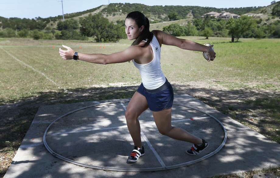 Boerne Geneva's Julie Perez, a senior who has signed with Rice, has the fifth-best discus throw in the state — public and private schools — and practices in a pasture at home complete with a concrete ring her father David made. She looks to win her third state championship in the event at the TAPPS state meet in Waco. Photo: Kin Man Hui /San Antonio Express-News / ©2017 San Antonio Express-News