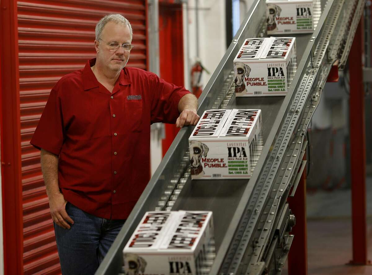 Lagunitas Brewing CEO Tony Magee watches cases come off the bottling line in Petaluma, Calif. Craft brew sensation Lagunitas Brewing Company has dropped its trademark infringement lawsuit against fellow brewer Sierra Nevada Brewing Wednesday January 14, 2015.