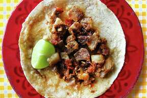 Taco of the Week: Chicharrón prensado taco on a handmade corn tortilla from Mi Ranchito.