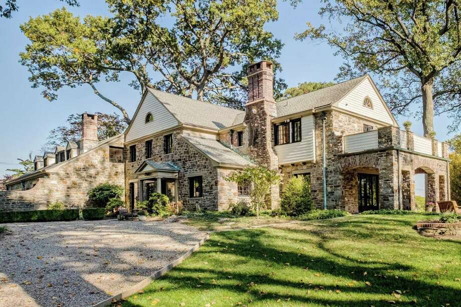 """Known as """"Ledgeoaks,"""" the home at 475 Algonquin Road in Fairfield was built in 1926 on three acres of land owned by Edgar Webb Bassick. The home was intended for his daughter and son-in-law. Though there have been renovations, the 5,493 square-foot-house has been kept to its original footprint, and proudly displays the original architectural drawings in its formal dining room. Photo: Nathan Spotts & Lauren Kinkade / Contributed Photo / Connecticut Post Contributed"""