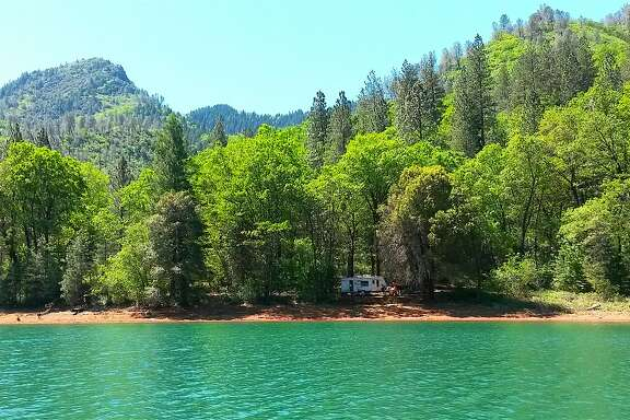 This lakeside campsite is at the Dekkas Rock Campground at Shasta Lake in Northern California