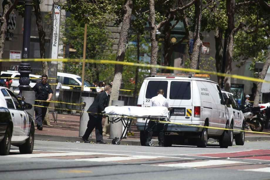 A body is transported to a medical examiner's van after a police shooting on the 900 block of Market Street on Wednesday, May 3, 2017 in San Francisco, Calif.