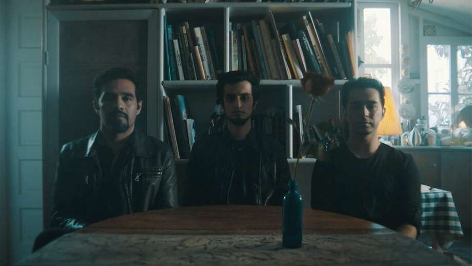 """Oakland-based Afghan band Kabul Dreams — bassist Siddique Ahmed (left), guitarist and singer Sulyman Qardash, and drummer Raby Adib — in """"Radio Dreams."""" Photo: Matson Films"""