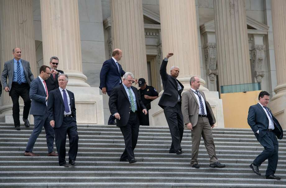 Lawmakers walk out of the US Capitol in Washington, DC, on May 4, 2017 after the House of Representatives narrowly passed a Republican effort to repeal and replace Obamacare, delivering a welcome victory to President Donald Trump after early legislative stumbles. Following weeks of in-party feuding and mounting pressure from the White House, lawmakers voted 217 to 213 to pass a bill dismantling much of Barack Obama's Affordable Care Act and allowing US states to opt out of many of the law's key health benefit guarantees. Photo: NICHOLAS KAMM/AFP/Getty Images