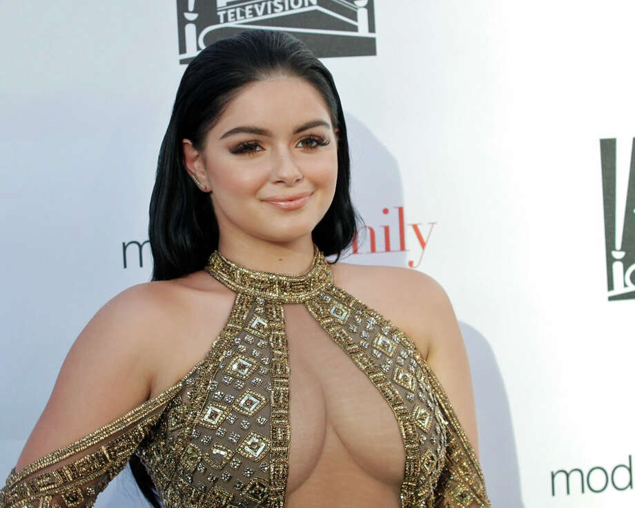 """Ariel Winter looked incredibly out of place among her casually dressed co-stars at the screening of the season eight finale of """"Modern Family."""" Her eye-popping dress is just one of her many bold looks."""