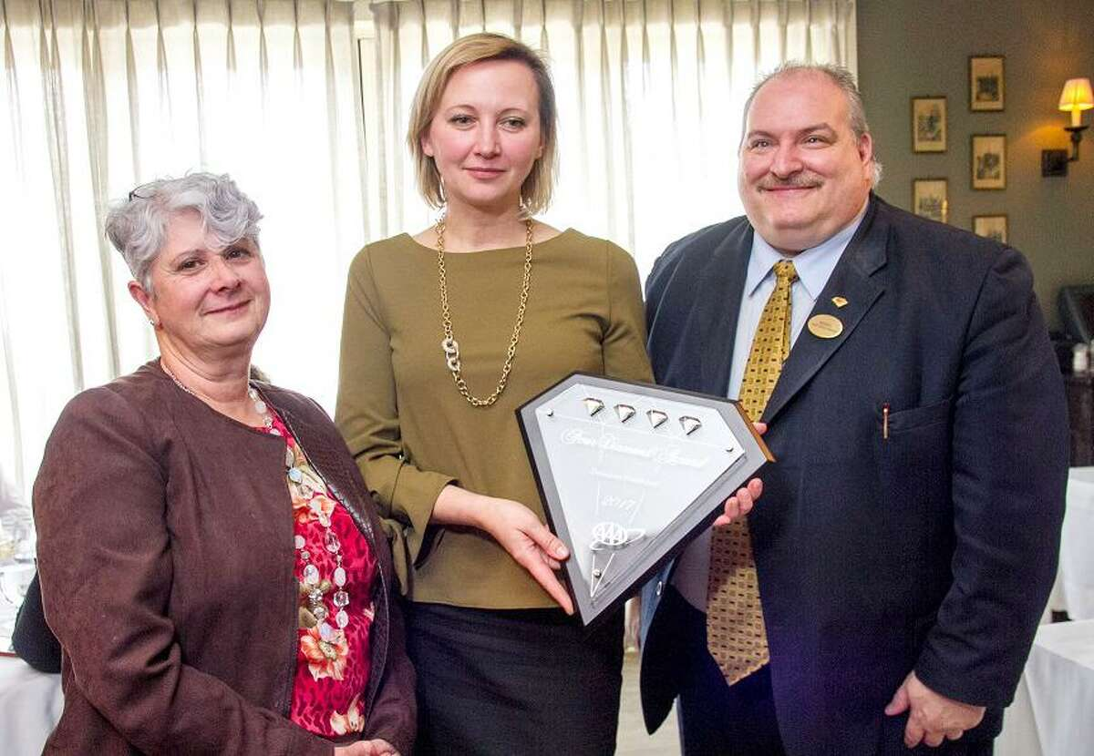 AAA Northeast's Fran Mayko, left, presents Mariya Sytnyk, the property manager of Delamar of Southport, and Michael Dugan, Delamar's front office manager, with a AAA Four Diamond award for the hote's world-class service, facilities and amenities.