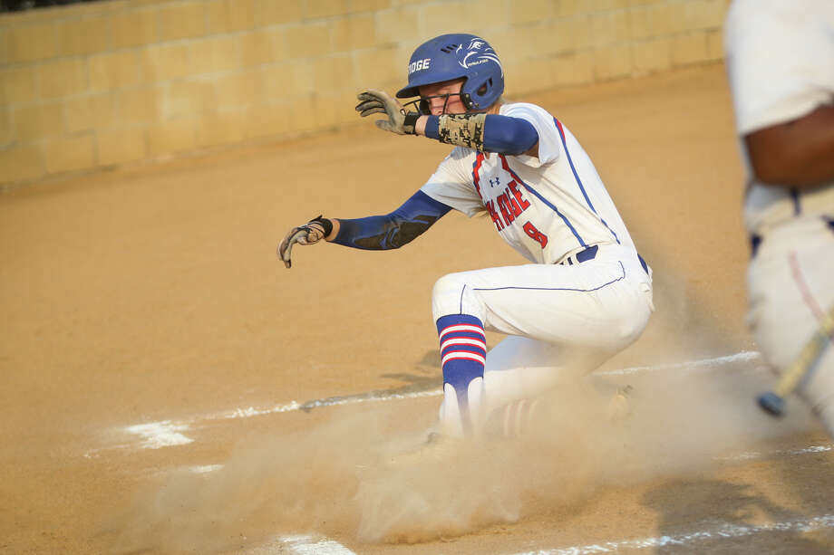 Oak Ridge's Haley Nillen (8) slides into home base for a run during the varsity softball game against Mesquite Horn on Friday, April 28, 2017, in Buffalo. (Michael Minasi / Chronicle) Photo: Michael Minasi, Staff Photographer / © 2017 Houston Chronicle