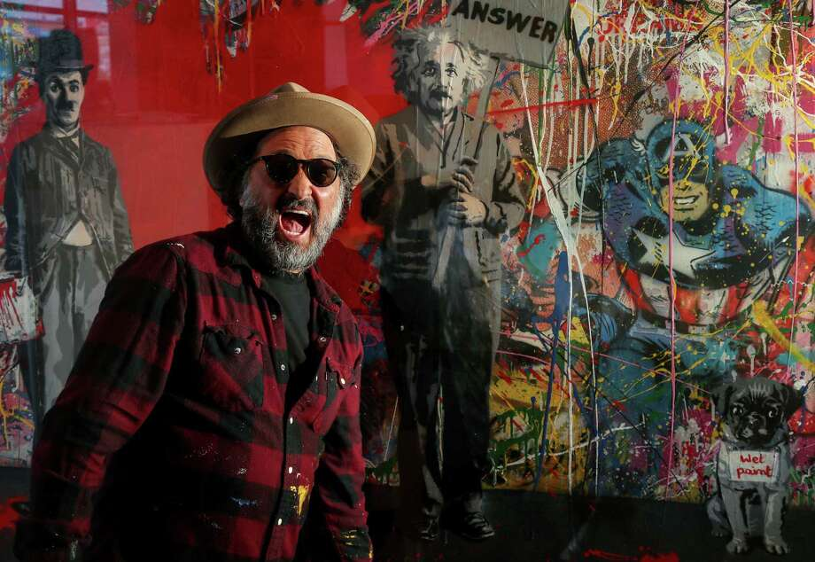 Brightly colored, splattery paintings of pop culture celebrities have made Mr. Brainwash an international star. Photo: Jon Shapley, Staff / © 2017 Houston Chronicle