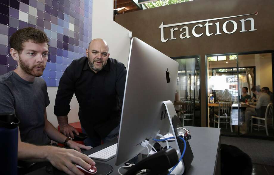 Ross Musil and CEO Adam Kleinberg at the front desk in the offices of San Francisco marketing firm Traction, on Thursday May 4, 2017. Photo: Michael Macor, The Chronicle