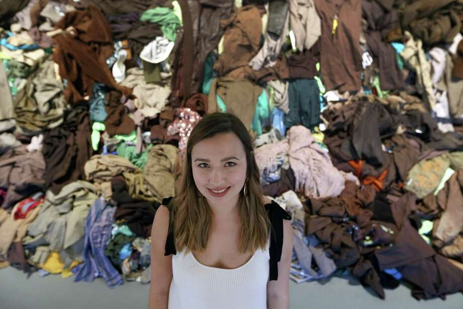 "Daniela Cavazos Madrigal poses in front of a landscape made out of clothes. The piece is one of the works in ""I Came From Wet,"" her MFA thesis exhibit at UTSA Terminal 136. Photo: William Luther /San Antonio Express-News / © 2017 San Antonio Express-News"