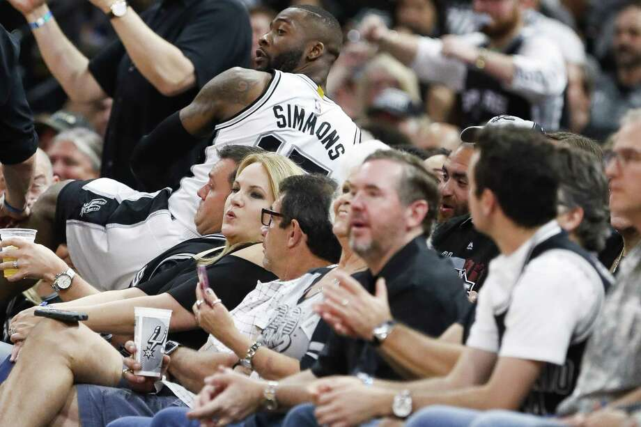Spurs guard Jonathon Simmons goes into the stands chasing a loose ball during the second half of Game 2 against Houston at the AT&T Center on May 3, 2017, in San Antonio. Photo: Karen Warren /Houston Chronicle / 2017 Houston Chronicle