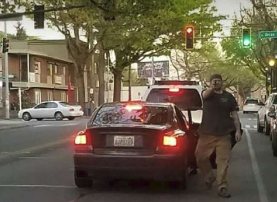 Seattle police hope to identify this man, who pulled a gun on two people Wednesday evening two people walking in the city's Columbia City neighborhood. A Seattle Police Department detective tasked with investigating hate crimes is reviewing the case. Anyone with information is asked to call at 206-684-5550.