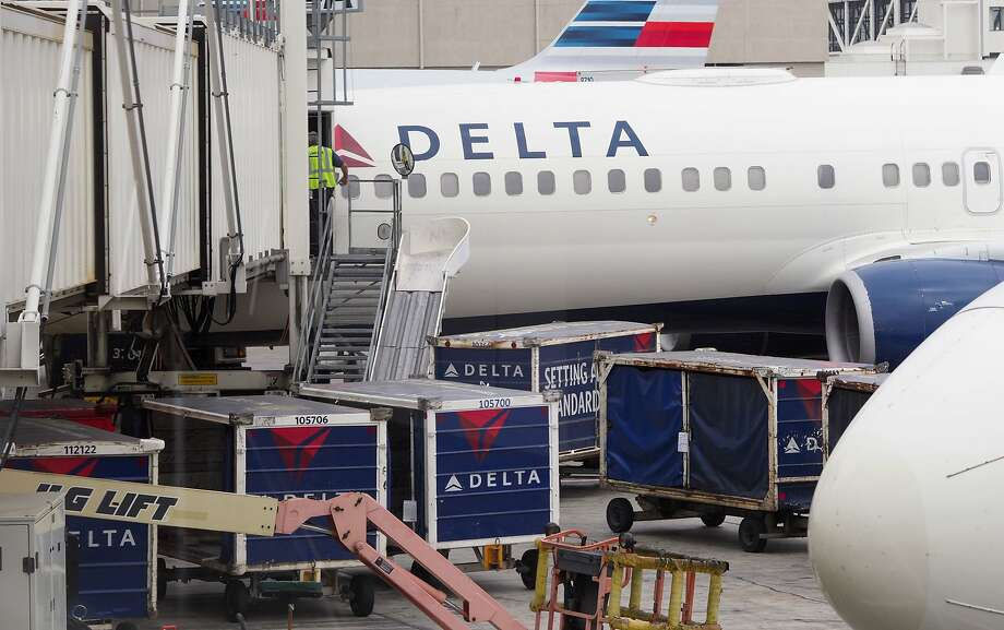A new scam uses Delta Airlines to steal personal information.>>Click to see where Delta and other airlines offer nonstop flights from Houston. Photo: ROBYN BECK, AFP/Getty Images