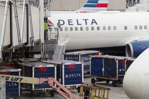 A passengers waits for a Delta Airlines flight in Terminal 5 at Los Angeles International Airport, May 4, 2017 in Los Angeles, California. In yet another incident that could prove a public relations nightmare for the airline industry, a California couple has come forward claiming they were kicked off an overbooked Delta flight for refusing to give up their child's seat. The incident unfolded last week as the Schear family of Huntington Beach were flying back home from Hawaii to Los Angeles. / AFP PHOTO / Robyn BeckROBYN BECK/AFP/Getty Images