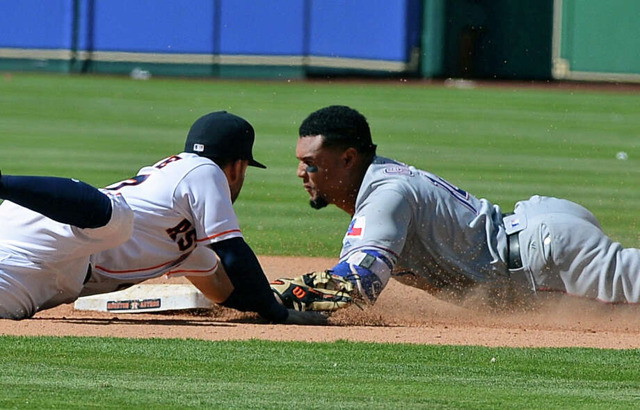 Texas Rangers' Carlos Gomez, right, slides safely in for a double ahead of the tag by Houston Astros second baseman Jose Altuve in the eighth inning of a baseball game Thursday, May 4, 2017, in Houston. (AP Photo/George Bridges) Photo: George Bridges, FRE / FR171217 AP