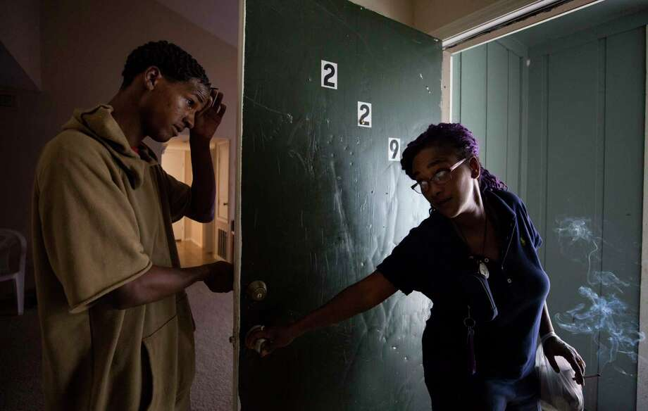 Cherika Argus, right, tells her son, Dontae Argus, to not leave the apartment as she says goodbye on her way to work at S&N Food Store Wednesday, May 3, 2017, in Houston. The Argus' moved to an apartment in Northwest Houston after being displaced from Briscoe's Place rooming house due to a fire that killed two people in March. Photo: Godofredo A. Vasquez, Houston Chronicle / Godofredo A. Vasquez