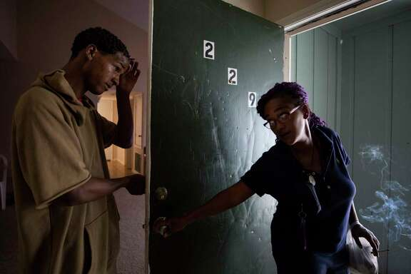 Cherika Argus, right, tells her son, Dontae Argus, to not leave the apartment as she says goodbye on her way to work at S&N Food Store Wednesday, May 3, 2017, in Houston. The Argus' moved to an apartment in Northwest Houston after being displaced from Briscoe's Place rooming house due to a fire that killed two people in March.