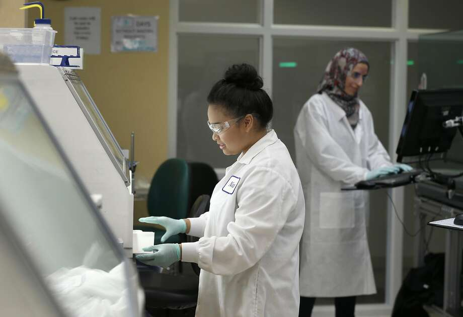 Karla Estabillo (left) and Nagla Alberawi test DNA samples at the Natera genetics lab in San Carlos on May 4, 2017. As genetic testing becomes more affordable, more health insurers are covering the costs for patients. Photo: Paul Chinn, The Chronicle