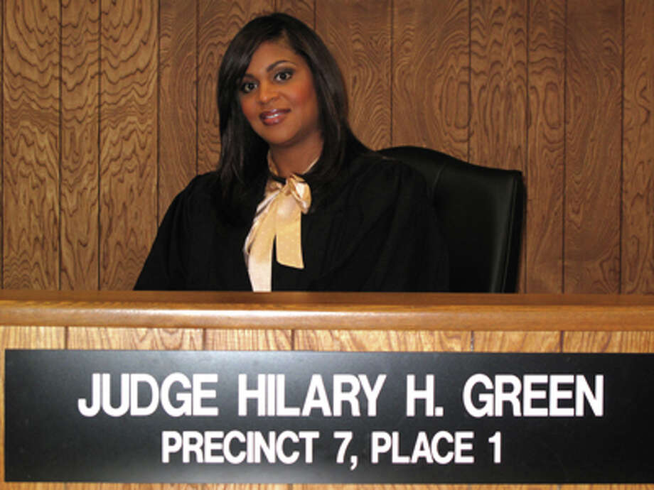 Houston-based Justice of the Peace Hilary Green has admitted that she 'sexted' and used drugs while on the bench - but is fighting her removal from office.