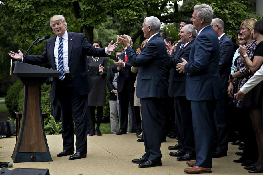 U.S. President Donald Trump, left, speaks during a press conference with House Republicans in the Rose Garden of the White House in Washington, D.C., U.S., on Thursday, May 4, 2017. House Republicans mustered just enough votes to pass their health-care bill Thursday, salvaging what at times appeared to be a doomed mission to repeal and partially replace Obamacare under intense pressure from Trump to produce legislative accomplishments. Photo: Andrew Harrer / Bloomberg / © 2017 Bloomberg Finance LP