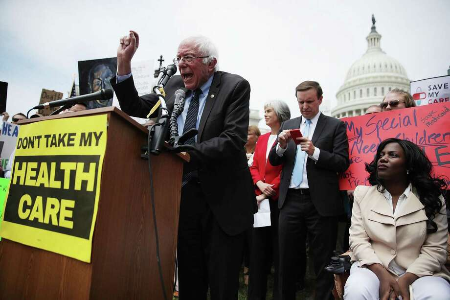 U.S. Sen. Bernie Sanders (I-VT) speaks during a Stop 'Trumpcare' rally May 4, 2017 in front of the Capitol in Washington, DC. U.S. Sen. Chris Murphy, D-Conn., right, and other Congressional Democrats joined activists for a rally to urge not to replace Obamacare, also known as the Affordable Care Act. Photo: Alex Wong / Getty Images / ONLINE_YES