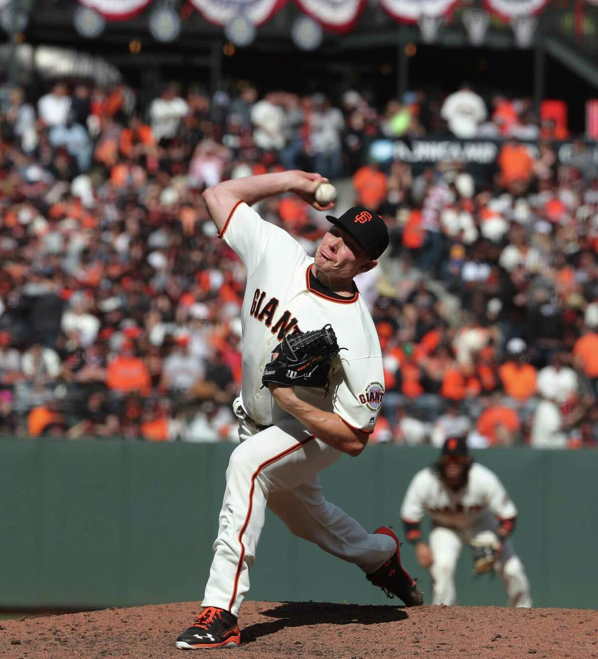 Giants' closer Mark Melancon throws in the ninth inning as the San Francisco Giants went on to beat the Arizona Diamondbacks 4-1 in their home opener at AT&T Park in San Francisco, Calif. on Mon. April 10, 2017.