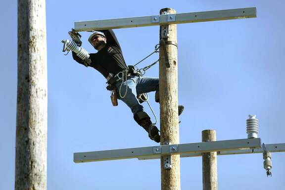A CPS Energy employee works to set up an obstacle for 2017's Lineworkers Rodeo. CPS Energy will be taking over operations and maintenance of natural gas and electricity infrastructure at Joint Base San Antonio facilities.