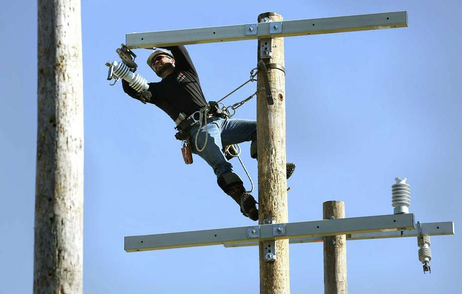 Leroy Smith changes out an insulator on a utility lineman obstacle course as he practices his skill in preparation of competing against teams from across the country at America's Public Power's Lineworkers Rodeo which will be hosted by CPS energy on May 6. Photo: Bob Owen, Staff / San Antonio Express-News / ©2017 San Antonio Express-News