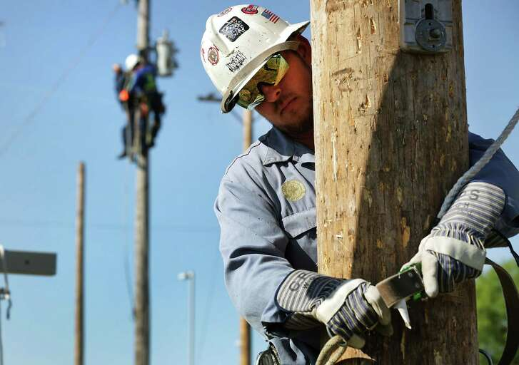 """Clarence """"Trey"""" Elley III, left, prepares to climb a utility pole as CPS lineworkers practice their skills last year in preparation for competing in America's Public Power's Lineworkers Rodeo. The application deadline for apply for one of the spots on the CPS Board of Trustees approaches."""