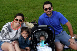 Katie and Jeff Beaver with children Margo, 3, and Gordon, 2 months, at the McFaddin-Ward House's spring picnic on Thursday evening.  Photo taken Thursday 5/4/17 Ryan Pelham/The Enterprise