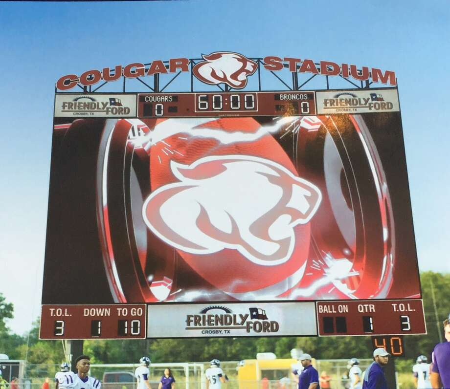 Crosby ISDathletes are in front of the Daktronics video board at Cougar Stadium which was installed last year. Photo: Courtesy Of Viviana Killion,Crosby ISD