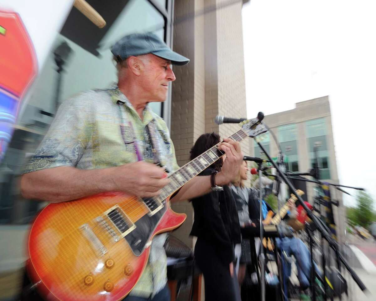 Riverside resident John Motay played guitar for the Exit 5 Band during the opening night of Art to the Avenue, celebrating its 20th year on Greenwich Avenue in Greenwich, Conn., Thursday night, May 4, 2017. The event runs until May 29th with the art available for viewing in all the participating stores.