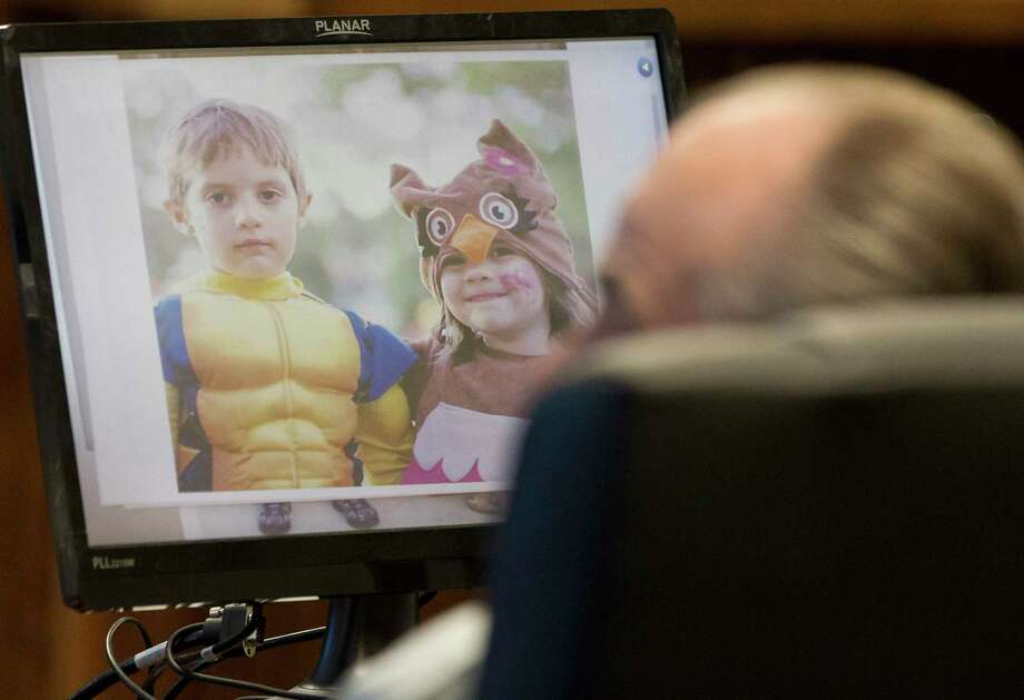 An image of Harley and Sofie Sedlmeier are seen in front of Ronald Cooper during his sentencing hearing in the 359th state District Court at the Montgomery County Courthouse, Thursday, May 4, 2017, in Conroe. Cooper, 69, was found guilty of driving high on prescription pills and crashing into the sedan carrying Harley and Sofie along with their parents as they headed home from church on a bright Sunday afternoon in 2015. Photo: Jason Fochtman, Staff Photographer / © 2017 Houston Chronicle