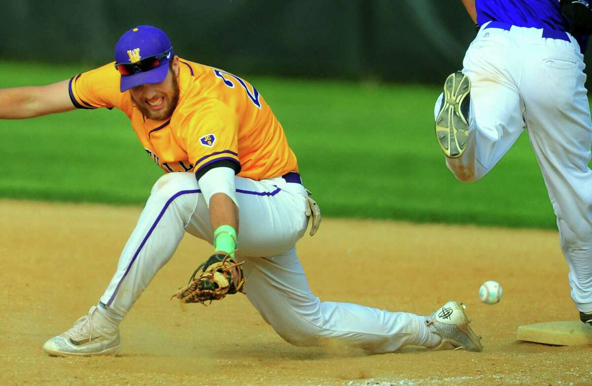 Westhill's Hunter Semmel misses the throw to first during baseball action against Fairfield Ludlowe at Kiwanis Field in Fairfield, Conn. on Thursday May 4, 2017. Ludlowe's Matt Landry was safe at first and the error allowed a run scored by teammate Connor Devaney.
