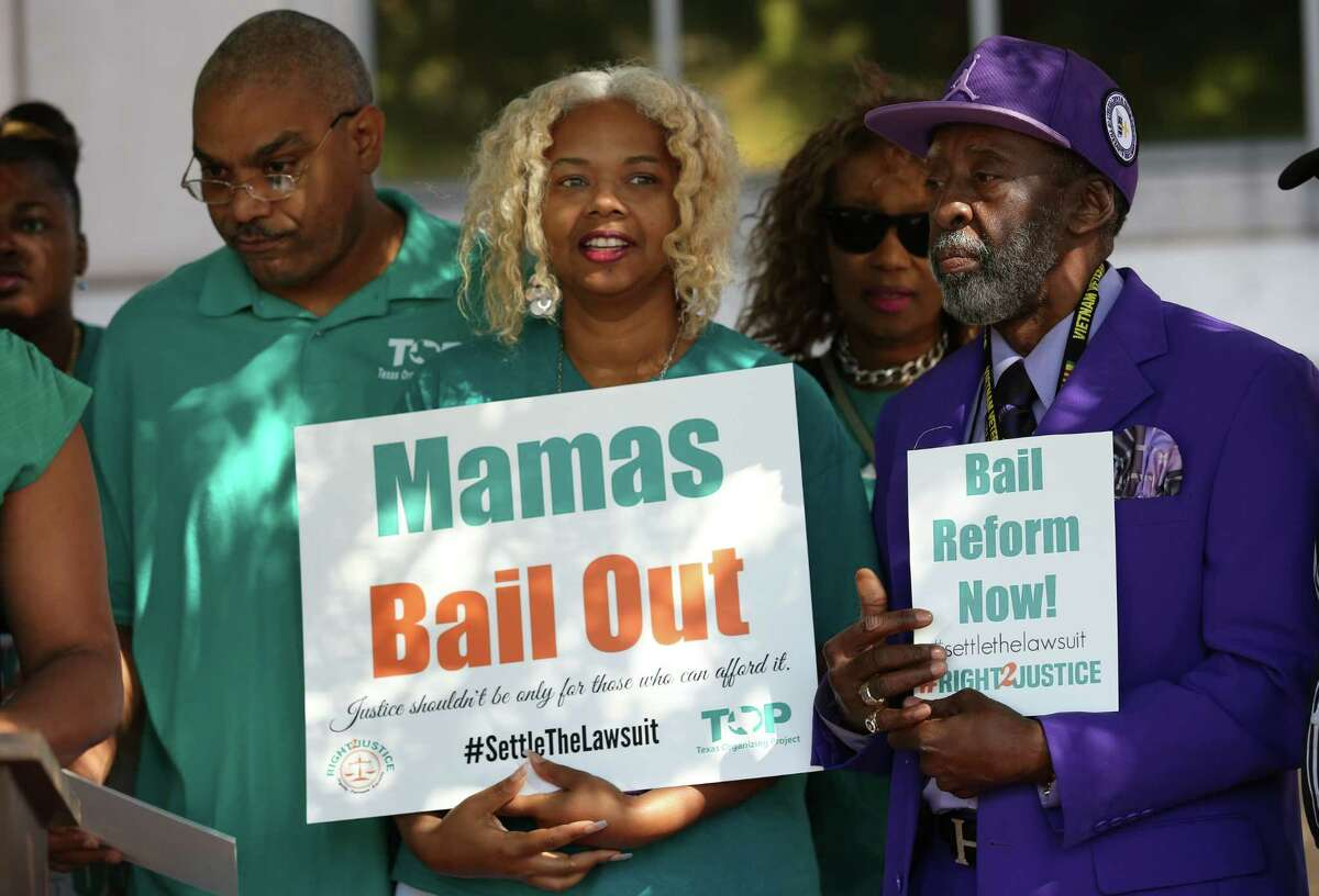 Feldon and Rita Bonner, from left, and Pastor Henry Price II were among activists rallying for bail reform at the Harris County Criminal Justice Center Thursday.