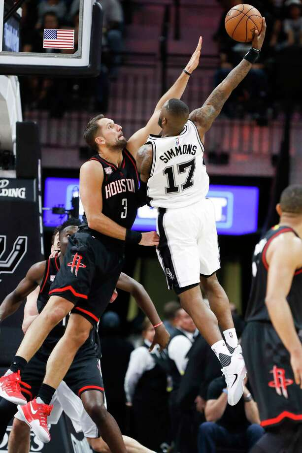 Spurs guard Jonathon Simmons, right, puts up a shot over Rockets forward Ryan Anderson in Game 2. Simmons contributed 14 points to the Spurs' win. Photo: Karen Warren, Staff Photographer / 2017 Houston Chronicle