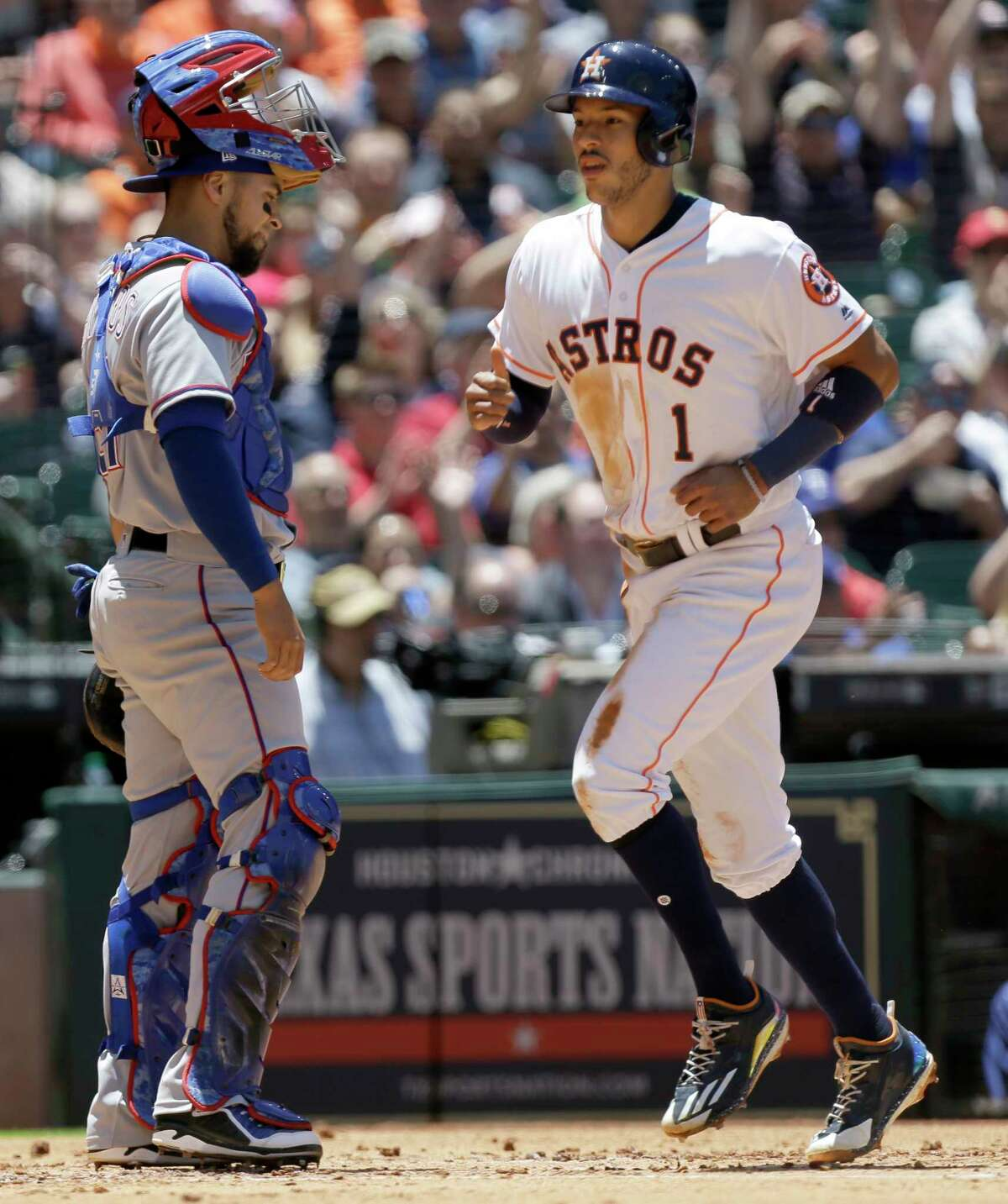 Texas Rangers catcher Robinson Chirinos waits as Houston Astros Carlos Correa crosses the plate on a RBI single hit by Evan Gattis during the first inning at Minute Maid Park Thursday, May 4, 2017, in Houston. ( Melissa Phillip / Houston Chronicle )