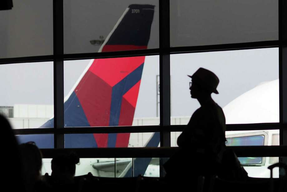 A passenger was forcibly removed from a Delta Flight 2646, from Tampa to LaGuardia, after refusing to deplane.Click through this slideshow to see other newsworthy incidents of people getting kicked off airplanes.  Photo: ROBYN BECK, Staff / AFP or licensors
