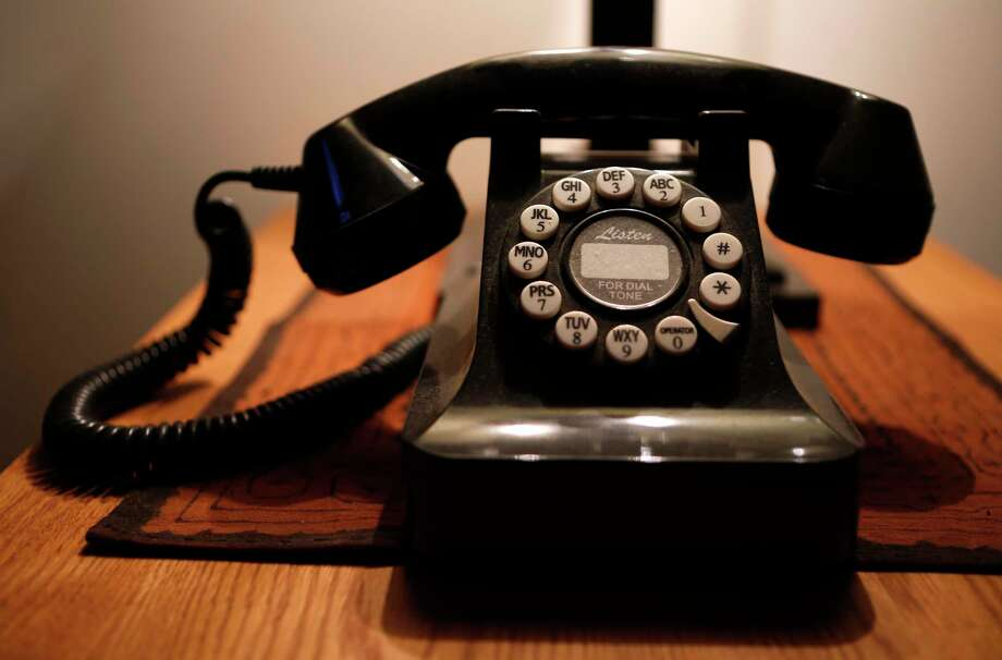 This push-button landline telephone has a vintage look. More than 39 percent of U.S. households have both landline and cellphone service.  Photo: Robert F. Bukaty, STF