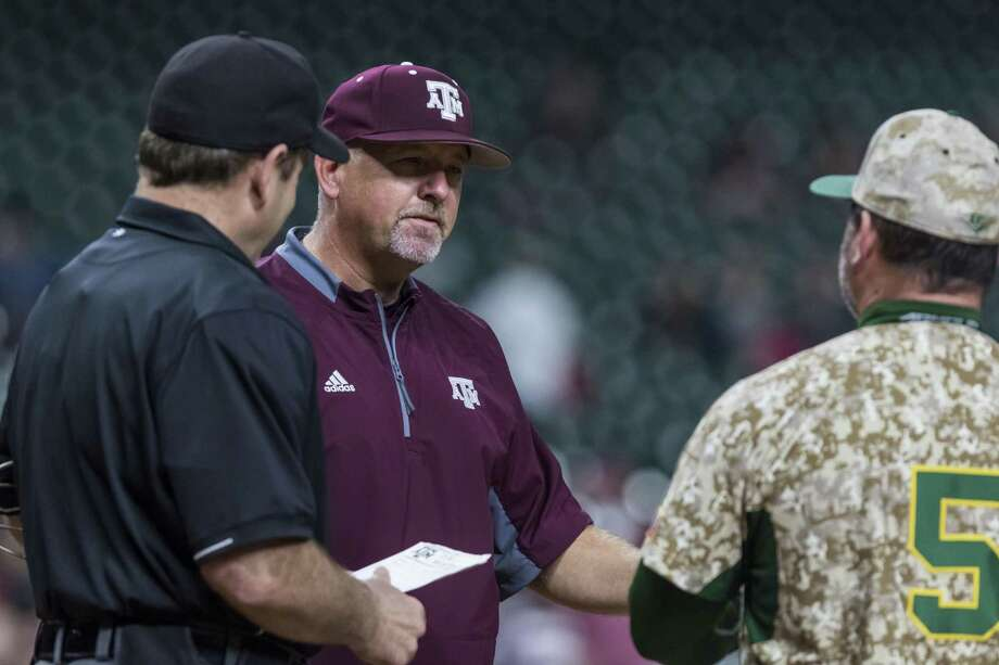 Texas A&M coach Rob Childress exchanges lineup cards before the game against Baylor at Minute Maid Park on March 5, 2017, in Houston. Photo: Joe Buvid /For The Houston Chronicle / © 2017 Joe Buvid