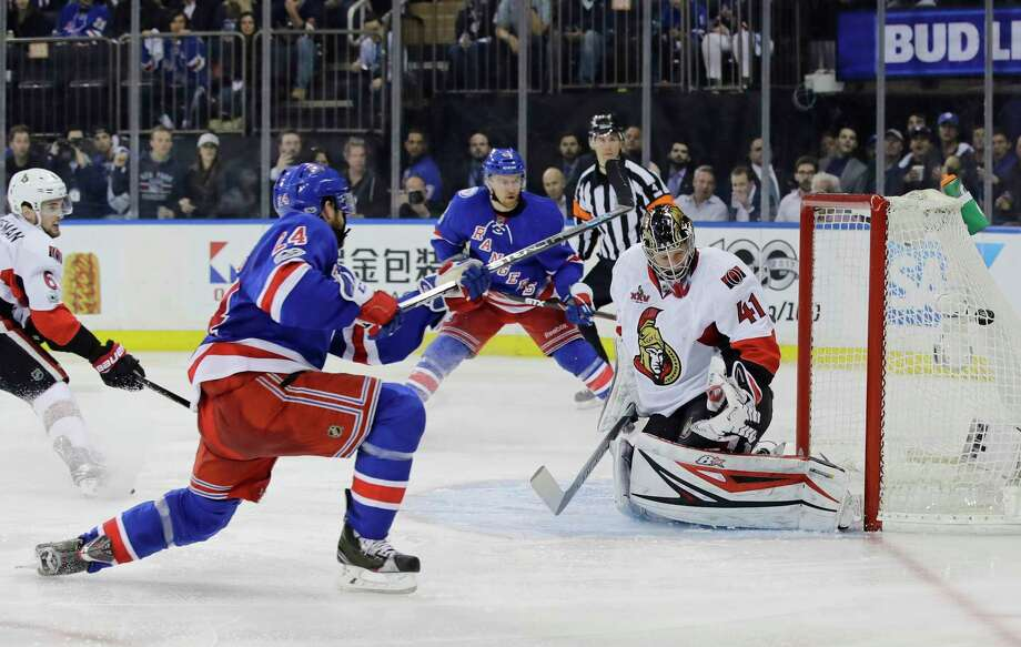 Oscar Lindberg (24) of the Rangers puts the puck past Senators  goalie Craig Anderson (41) in the second period Thursday. Photo: Frank Franklin II, STF / Copyright 2017 The Associated Press. All rights reserved.