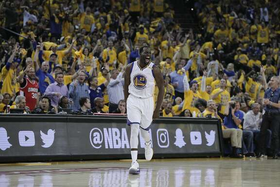 Golden State Warriors' Draymond Green reacts after hitting one of his first quarter three-pointers during Game 2 of the Western Conference Semifinals 2017 NBA Playoffs at Oracle Arena on Thursday, May 4, 2017 in Oakland, Calif.
