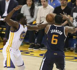Golden State Warriors' Draymond Green knocks the ball away from Utah Jazz' Joe Johnson in the second quarter during Game 2 of the Western Conference Semifinals 2017 NBA Playoffs at Oracle Arena on Thursday, May 4, 2017 in Oakland, Calif.