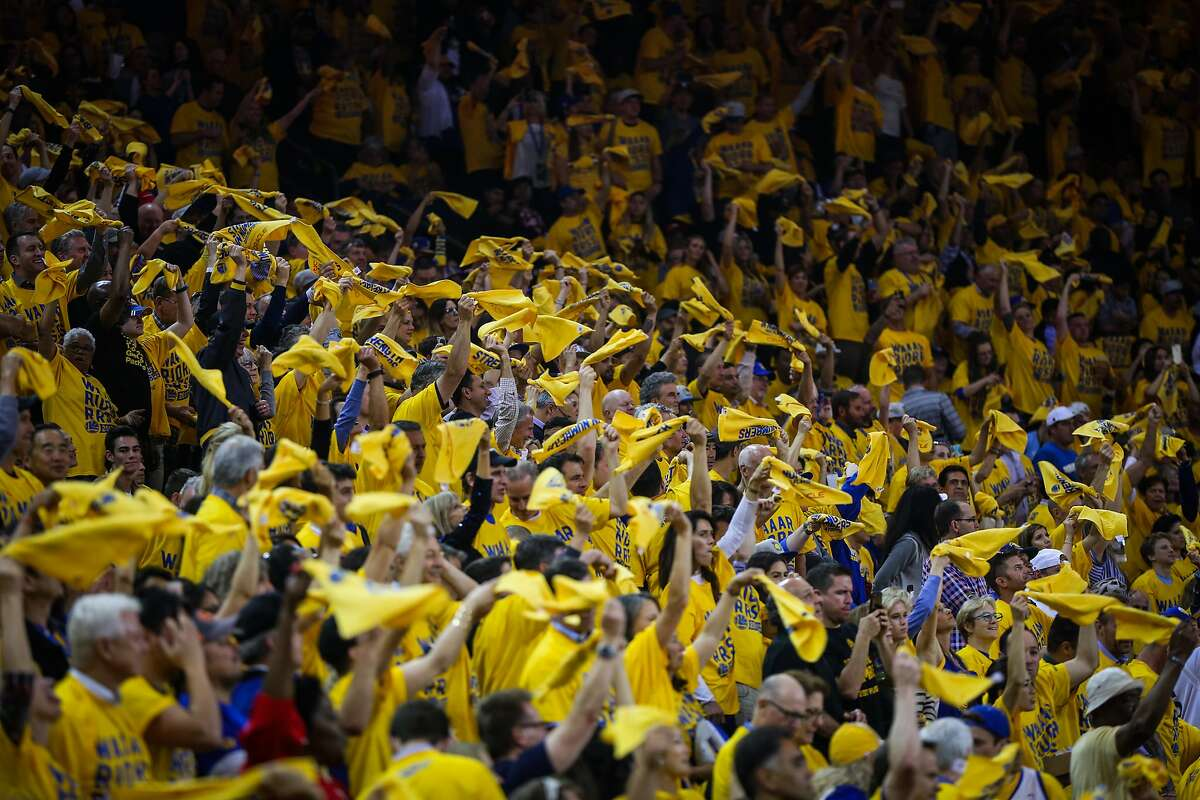 Fans cheer after the Warriors score in the first half of Game 2 of the Western Conference Semifinals 2017 NBA playoffs between the Golden State Warriors and Utah Jazz at Oracle Arena in Oakland, California, on Thursday, May 4, 2017.