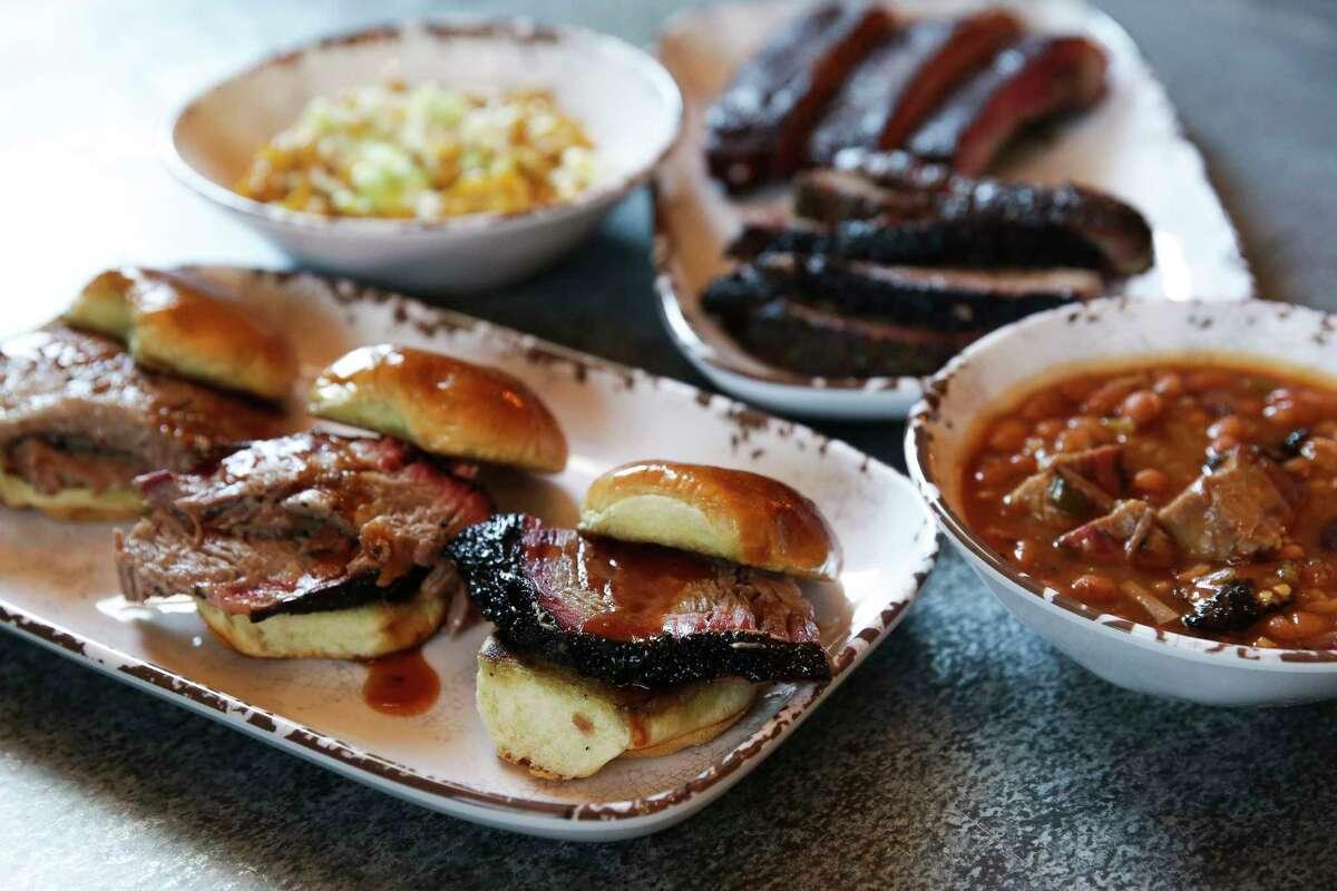 Brisket sliders, beans, corn, ribs and sliced brisket at Smoke'n Honey House, 8801 North Loop East.