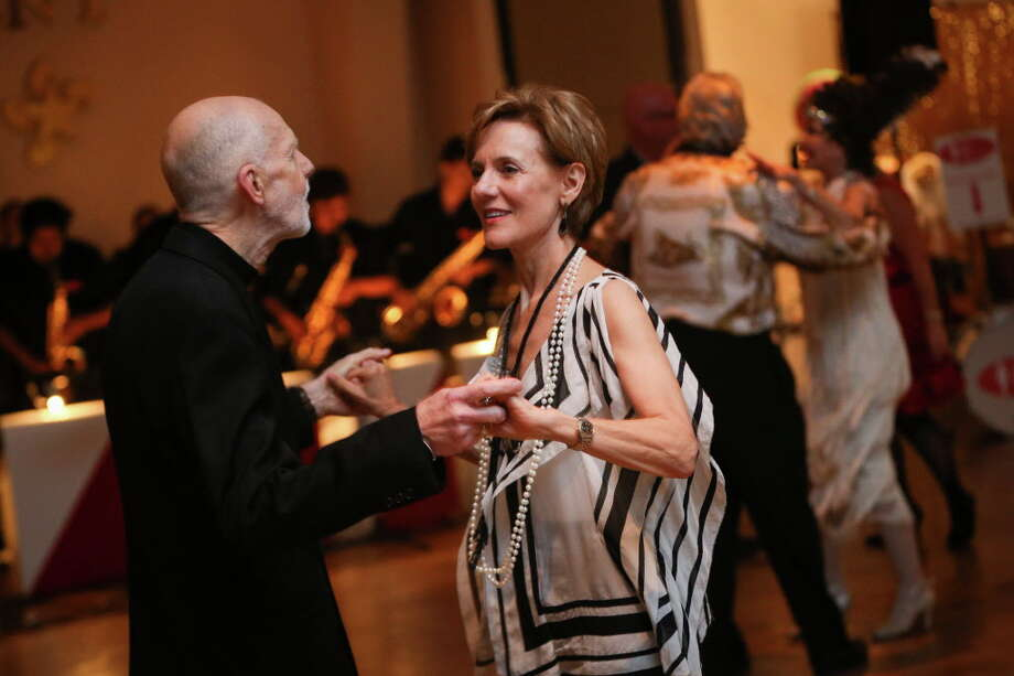 Susie Pokorski, Chairman of the Young Texas Artists Music Competition, dances with her husband Jim, founder of the competition, during Conroe Symphony Orchestra's 20th anniversary All That Jazz Gala on Saturday, April 29, 2017, at the North Montgomery County Community Center in Willis. Photo: Michael Minasi, Staff Photographer / © 2017 Houston Chronicle