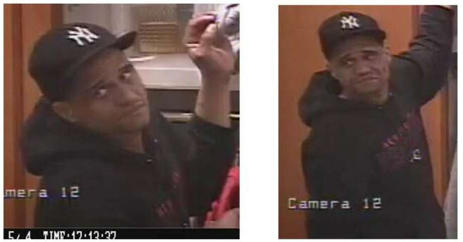 An unidentified suspect pictured in mall security footage is accused of shoplifting and threatening a security guard with a needle. Photo: Contributed Photo / Milford Police / Contributed Photo / Connecticut Post
