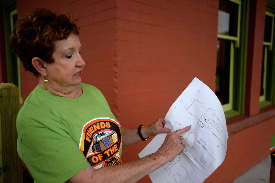 Carol Sims shows blueprints at the renovated Orange Train Depot Museum on Wednesday afternoon. The depot will hold an open house on Sunday.  Photo taken Wednesday 5/3/17 Ryan Pelham/The Enterprise Photo: Ryan Pelham / ©2017 The Beaumont Enterprise/Ryan Pelham
